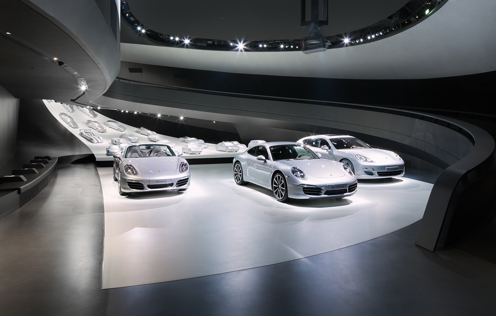 Porsche Pavilion, Wolfsburg, Germany. In the exhibition space, 25 silver vehicle models are on show, including the original Porsche – a 356 No.1 built in 1948.
